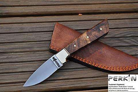couteau de chasse à la main - couteau bushcraft