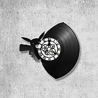 Disque vinyle 33 tours (envi 30cm) recyclé en horloge murale déco. Ce sont des disques de récupération et peuvent présenter des micro rayures. Les découpes sont réalisées à la main à la scie a chantourné dans notre atelier situé en Seine-et-Marne. Ce...