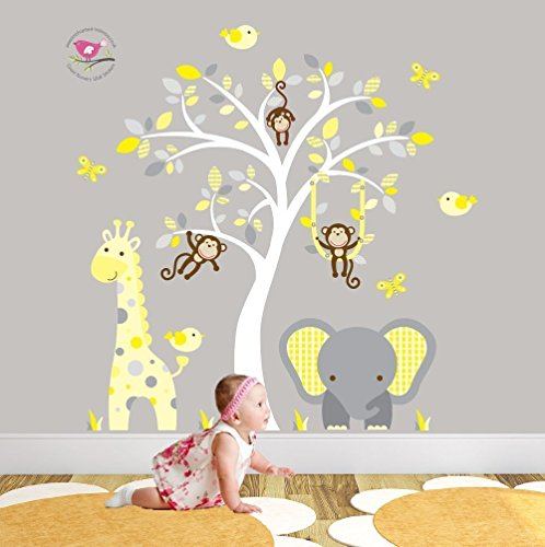jungle-nursery-wall-art-featuring-a-giraffe-elephant-and-monkeys-around-a-white-tree-mural-yellow-an
