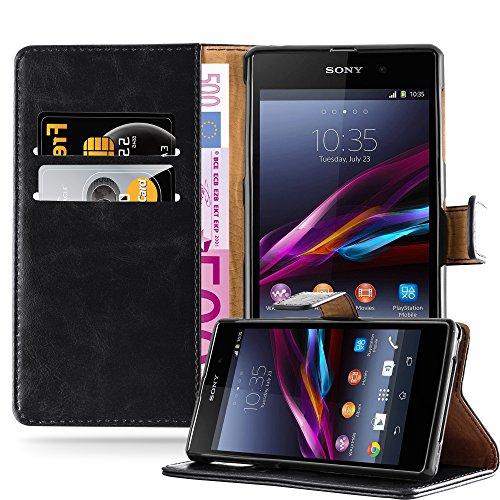 Cadorabo - Funda Estilo Book Lujo para Sony Xperia Z1 con Tarjetero y Función de Suporte - Etui Case Cover Carcasa Caja Protección en NEGRO-GRAFITO