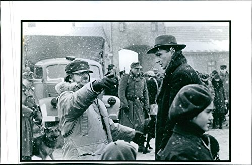 vintage-photo-of-liam-neeson-and-director-producer-steven-spielberg-discuss-a-scene-in-schindlers-li