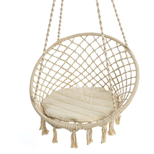Cream coloured hanging chair with round quilted cotton ...