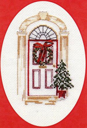 Cartolina per gli auguri di natale in punto e croce, disegno di una porta addobbata (lingua italiana non garantita)