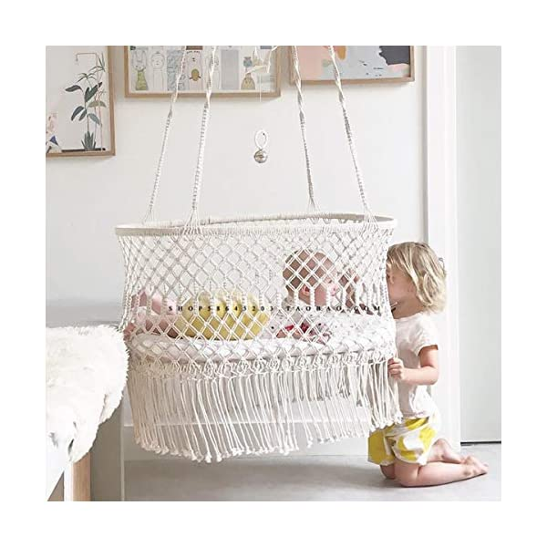 OLDFAI Baby Cradle Hanging Bassinet, Portable Baby Handmade Natural Cotton Swing Hammock for Boys Girls, Comfortable Breathable Large Capacity Hanging Crib Indoor Outdoor OLDFAI [BABY CRADLE BASSINET]Adorable hanging cradle soothes infants with a safe and comfortable place to sleep - Perfect addition to baby nursery or bedroom [SOOTHING & COMFORTABLE]Lulls baby to sleep with gentle rocking movement like a hanging baby hammock - Parents can rock cradle or let baby's movements gently move the baby swing crib - Gives new parents relaxation and peace of mind [INDOOR/OUTDOOR]Place the baby hammock bed cradle anywhere with sturdy suspension - Baby Nursery, living room, bedroom, basement, spare room, sunroom, patio, backyard, and more - Suspend beside your bed indoors or place the baby portable swing outdoors for a relaxing scenery - Practical alternative for those seeking more options than traditional crib 4