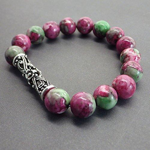 Armband in grün und rot Jade und zentrale tibetische Perle in filigran