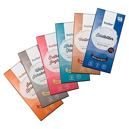 Xucker Schokoladenkombi 6 x 100 g Xylit-Schokoladen-Tafeln: 1x Edelbitter-, 1x Vollmilch- und 1x Weiße Schokolade mit Kokosraspeln und Weizenflakes sowie 1x Weiße Schokolade mit Erdbeere und Joghurt, 1x Weiße Schokolade, 1x Vollmilch mit Salz & Karamell - zusammen 600g