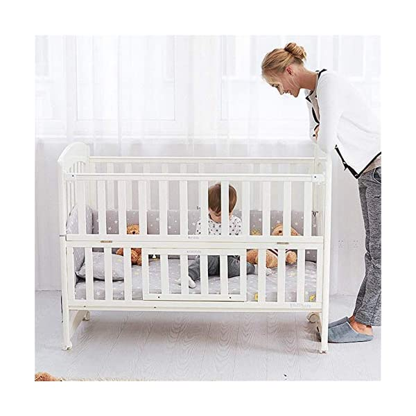 Solid Wooden Baby Cot,toddler Bed, Multifunctional White Cradle Bed Newborn Stitching, Height Adjustable HXYL Package contains bed, mosquito net, mosquito net pole, moving caster, kit Split panel for connecting to a large bed Three heights are adjustable to suit your child's different needs 5