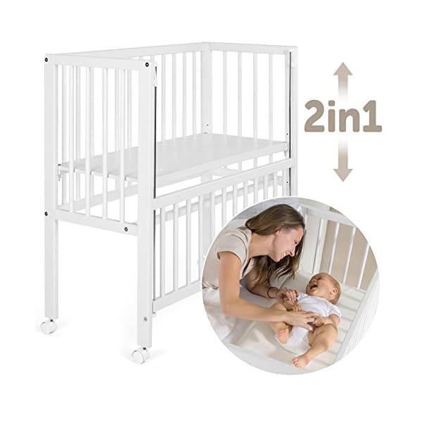 Fillikid Convertible Bedside Crib Vario 2in1 - Height Adjustable Bedside Cot with Wheels | 90 x 40 cm | Solid Beech Wood | Drop Side Rail | Fits Boxspring Beds - White  BEDSIDE CRIB DURING THE NIGHT: The bedside cot enables an easy access, hassle-free night time feeding and allows you to reach your baby without having to get up in the middle of the night. BASSINET DURING THE DAY: Simply pull up the side rail and use the cot as a stand-alone bed or bassinet. Four lockable wheels make it easy for you to move from one room to another having your newborn always on your side. FITS STANDARD AND BOXSPRING BEDS: The bed base can be placed on 4 different heights. It fits on every parent's mattress with a minimum height of 52 cm and a maximum height of 70 cm. The Vario Bedside Crib can easily be attached to your bed with the included support strap. 1