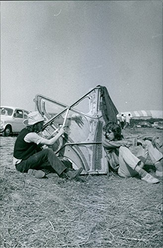 vintage-photo-of-vintage-photo-of-two-men-sitting-on-the-grass-one-is-playing-the-harp-during-the-so