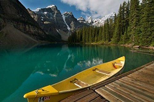 The Poster Corp Raymond Klass/DanitaDelimont - Canoe Along Moraine Lake Banff National Park Banff Photo Print (69,85 x 46,41 cm) -