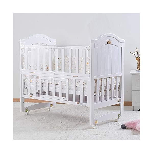 VBARV Multifunctional cradle bed-three-in-one stitching large bed solid wood crib, pine oversized children's play bed, bedroom furniture suitable for children aged 0-12 VBARV Non-toxic environmental protection material, no sharp fixing device, external dimensions are 125x72x104cm. Side-open fence, drowsy, easy to care for babies and able to hug in and out; can be spliced   into a large bed for easy feeding. The bed has four positions and is adjustable in height. The bed can be turned into a playground, cradle bed, sofa, desk, and is a multifunctional bed. Easy to clean and maintain: The surface of the crib can be wiped with a damp cloth to remove dust or dirt from the surface. 3