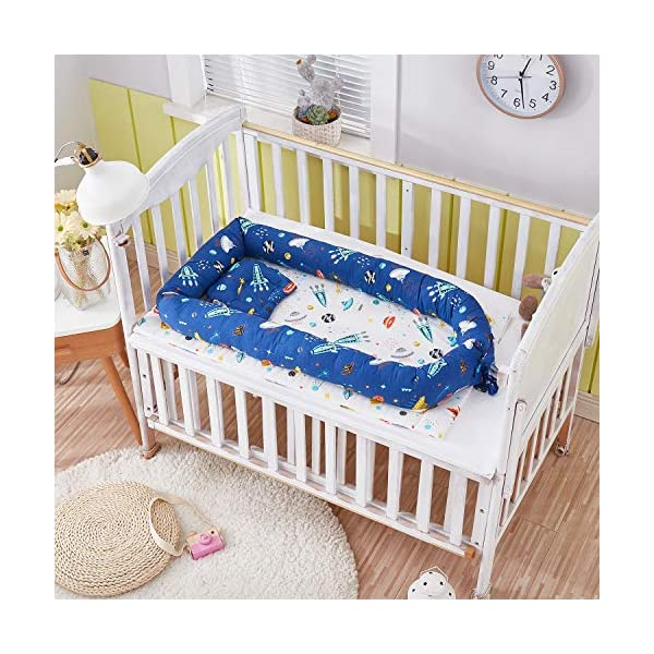 TEALP Multifunctional Baby Nest Navy Blue Galaxy Outer Space, Baby Bassinet for Bed/Lounger/Nest/Pod/Cot Bed/Sleeping, Breathable & Hypoallergenic Cotton (0-24 Months) TEALP 【Breathable and Hypoallergenic Cotton】hypoallergenic materials, breathable and non-toxic. We use 100-percent cotton fabric and breathable, hypoallergenic internal filler, which is safe for baby's sensitive skin. It will give your child serene, safe, and sound sleep in their lovely co sleeping crib. 【Adjustable Design】1 baby nest, 90x55x15cm;1 pillow30x30cm, Suitable for 0-24 Month. GROWS WITH YOUR BABY. Being adjustable, the side sleeper grows with your baby. Simply loosen the cord at the end of the bumpers to make the size larger. The ends of the bumpers can be fully opened. 【Multifunctional and Portable】 Use the infant nest as a bassinet for a bed, baby lounger pillow, travel bed, newborn pillow, changing station or move it around the house for lounging or tummy time, making baby feel more secure and cozy. 4
