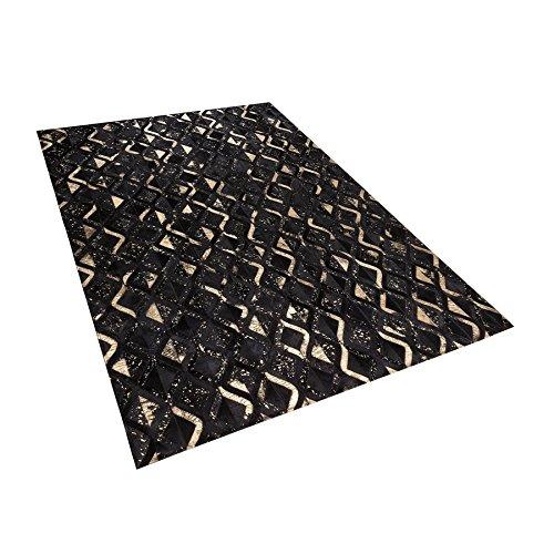 Beliani Tapis Noir et doré aux Motifs géométriques 140 x 200 cm Develi