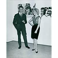 Vintage photo of Celebrity couple standing in a jolly mode. - Celebrity Magazine