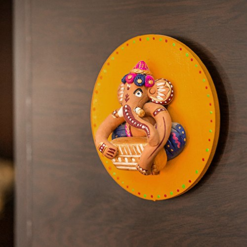 ExclusiveLane Terracotta Handpainted Round Ganesha Wall Décor - Wooden Wall Decoration, Home Décor Accents Wall Décor & Hanging Religious Gift Item  available at amazon for Rs.499