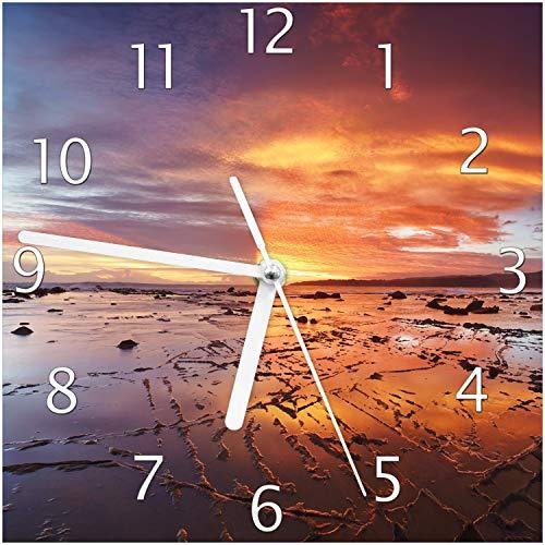 Wallario Glas-Uhr Echtglas Wanduhr Motivuhr; in Premium-Qualität; Größe: 20x20cm; Motiv: Wattwanderung am Meer bei Sonnenuntergang