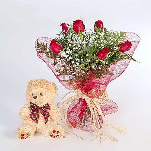 Ramo realizado con 6 rosas rojas y sus verdes, el ramo va acompañado de un osito generico de 15 cm.