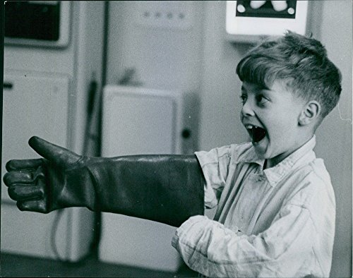 vintage-photo-of-a-young-boy-happily-put-on-a-glove-and-started-playing-with-it-1955