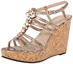 These Womens Adrienne Vittadini Cadenza Wedge Sandals are guaranteed authentic. They're crafted with care, and the closure is Buckle. The heel height is 4 1/2 inches, the size is 10 Medium (B,M), and the color is Champagne.