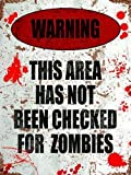Warning!. This area has not been checked for zombies. Funny, scary, horror, gore. Warning sign with blood splats. Living dead, Shaun of the dead, dawn, thriller. Fridge Magnet