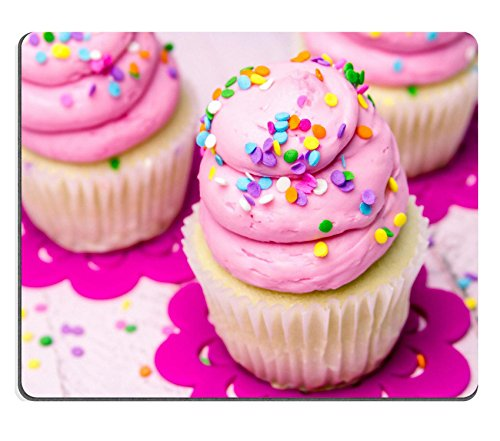 aming Mousepad IMAGE ID: 31450991 3 fresh baked vanilla cupcakes with pink swirled strawberry frosting topped with colorful sprinkles sitting on flower cut outs (Flower Cut-outs)