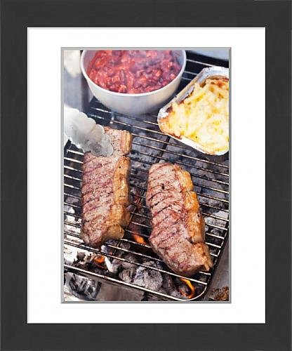 framed-print-of-beef-steaks-tomato-beans-and-macaroni-and-cheese-on-a-grill