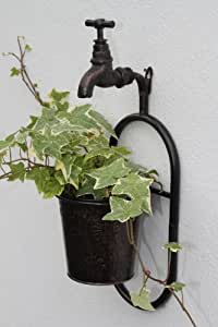 Metal Wall Single Plant Holder With Ornate Tap Feature With an Antique Copper Finish