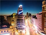 Cuadro sobre lienzo 120 x 90 cm: Gran Via shopping street and city of Madrid at night de Matteo...