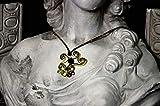 Ciondolo in fettuccia di alluminio dorato e bronzo da 3,5 mm, con inserto in Swarovsky cubico nero