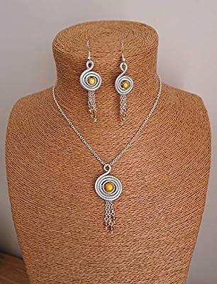 Parure spirale aluminium strié argent en ses perles. Coloris jaune
