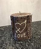 Kerzenbaumstamm mit Herz