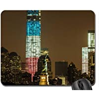 statue of liberty in front of red white and blue tower Mouse Pad, Mousepad (Monuments Mouse Pad)