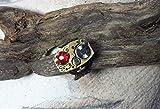 Bijou steampunk, bague ajustable, mécanisme de montre couleur or, cabochon plat de cristal swarovski rouge et orange, filigrane couleur bronze, 2 vrais petits rubis