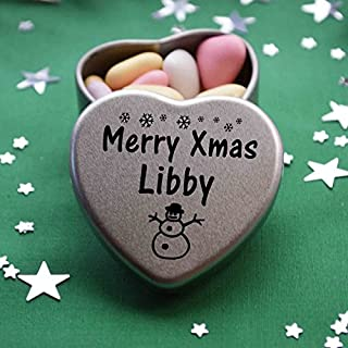 Merry Xmas Libby Mini Heart Gift Tin with Chocolates Fits Beautifully in the palm of your hand. Great Christmas Present for Libby Makes the perfect Stocking Filler or Card alternative. Tin Dimensions 45mmx45mmx20mm. Three designs Available, Father Christmas, Snowman and Snowflakes. They also make perfect Secret Santa Gifts.