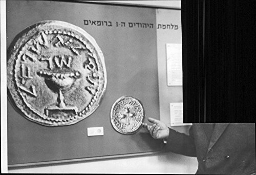 vintage-photo-of-demonstar-tion-of-some-hefty-coin-from-israel