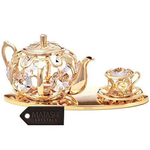 Té con adorno de cristales por Matashi, metal, Gold with Clear Crysta