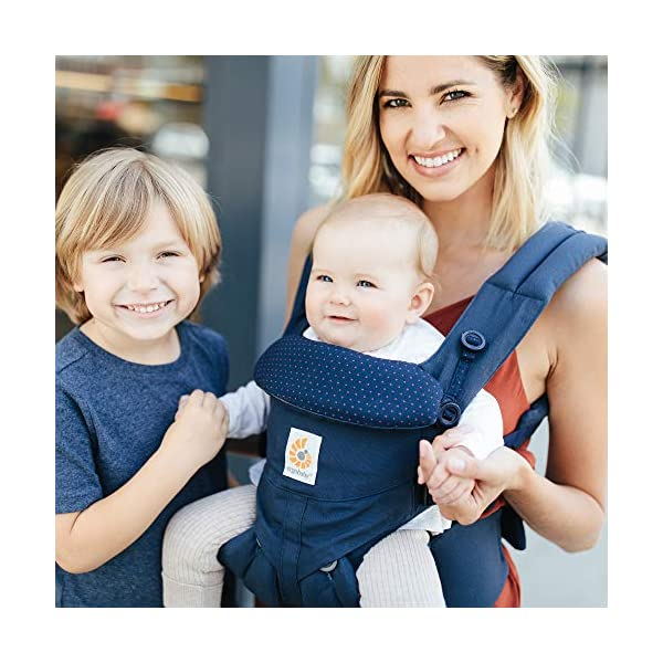 """ERGObaby Baby Carrier for Newborn to Toddler, 4-Position Omni 360 Navy Mini Dots, Ergonomic Child Carrier Backpack Ergobaby Baby carrier with 4 ergonomic wearing positions: parent facing, on the back, on the hip and on the front facing outwards. Supports hip-healthy """"m"""" shape position for baby's comfort and ergonomics. Adapts to baby's growth: Infant baby carrier newborn to toddler (7-33 lbs./ 3.2 to 20 kg), no infant insert needed. Tuck-away baby hood for sun protection (UPF 50+) and privacy. NEW - Maximum comfort for parent: Longwear comfort with lumbar support waistbelt and extra cushioned shoulder straps. 5"""