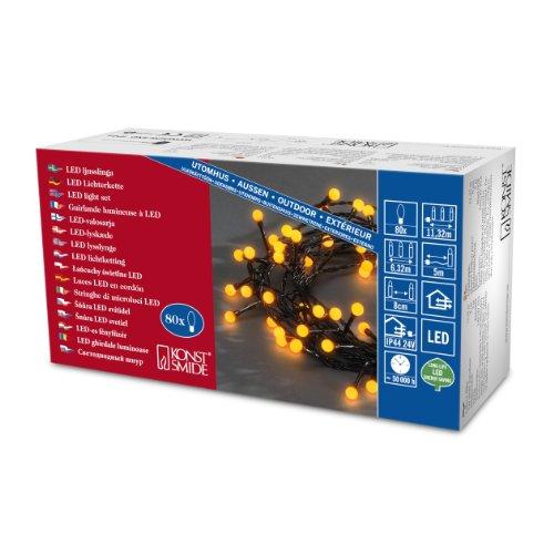 Konstsmide 3691-007 LED Globelichterkette mit runden Dioden / für Außen (IP44) /  24V Außentrafo / 80 gelbe Dioden / schwarzes Kabel
