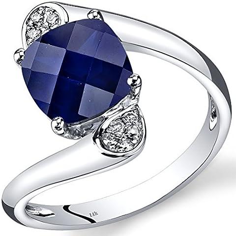 Revoni-Collana in oro bianco 14 kt con zaffiro blu taglio a cuscino e diamanti ct 3,08-Anello