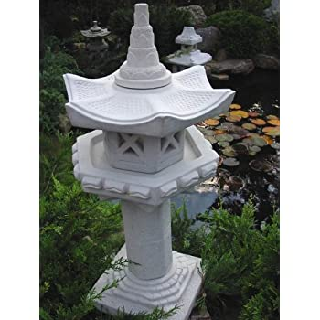 vogelhaus auf s ule japanische steinlaterne garten. Black Bedroom Furniture Sets. Home Design Ideas