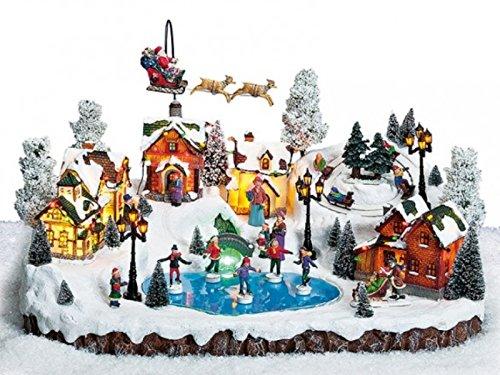 meindekoartikel Große Winterszene Dorf mit Teich und Schlittschuhläufer bewegt b51xt38xh32cm