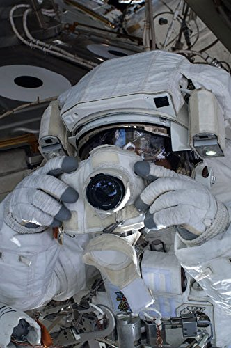 The Poster Corp Stocktrek Images - Astronaut uses a digital still Camera During a Spacewalk Kunstdruck (27,94 x 43,18 cm) Digital Still Camera