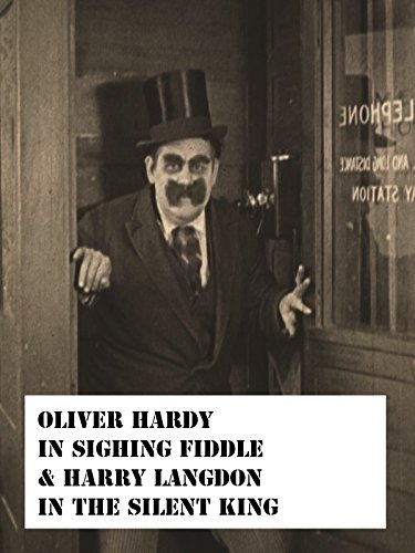 oliver-hardy-in-signing-fiddle-harry-langdon-in-the-silent-king-ov