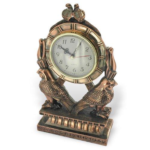 pendule-motifs-faucons-dieu-horus-peinture-metallisee-cuivre