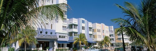 South Beach Miami Art Deco (Panoramic Images – This is the art deco district of South Beach Miami. The buildings are painted in pastel colors surrounded by tropical palm trees. Photo Print (68,58 x 22,86 cm))