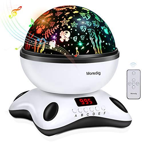 Moredig Lámpara proyector estrellas, 360 grados rotación músic lampara con temporizador led pantalla y control remoto, 8 modos romántica luz de la noche, perfecto regalo para bebés, niños, cumpleaños, día de los Reyes, Navidad, etc - Blanco y negro [Clase de eficiencia energética A+++]