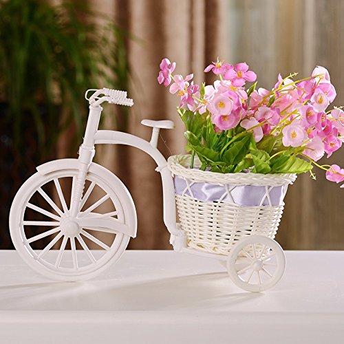 Die Rattan Möbel Handwerk drei Umläufe der Blume Fahrzeug verbringen blaue Blumen dekoriert ist und in einem idyllischen frische Ideen mit weißen Blumen + Dreirad eingerichtet, rosa Blume, Dreirad