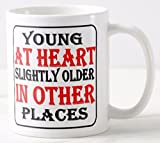 Novelty MUG ≈ YOUNG AT HEART - SLIGHTLY OLDER IN OTHER PLACES ≈ a fun slightly rude fun adult mens or ladies fun gift - great for birthday mothers or fathers day or christmas - perfect adult humour themed gift for any tea or coffee drinker ≈ listing category ceramic mug mugs cup cups gift gifts present presents