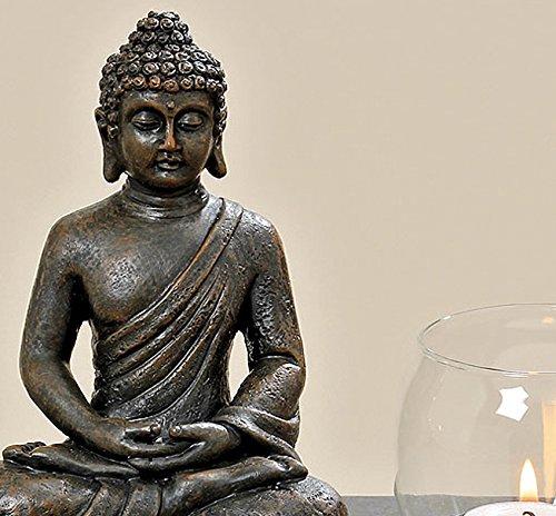 buddha-figur-auf-podest-mit-2-windlichtern-2