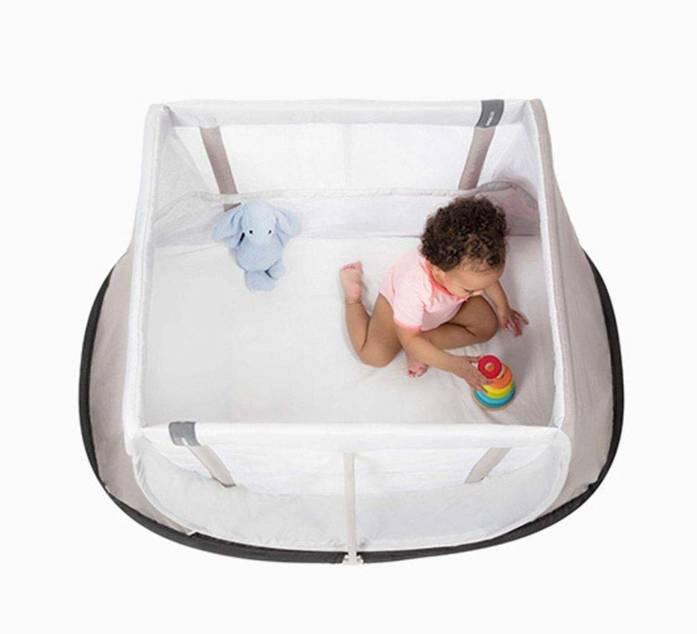 AEROMOOV - Instant Travel Bed - Allows Your Child to take a nap Wherever You are - Light and Compact - White Sand AeroMoov COMPACT AND LIGHT: No more carrying a heavy and bulky travel bed! The AeroMoov Instant Travel Bed weighs less than 5kg and is easy to store thanks to its slim and elegant storage bag. TO BE TAKEN EVERYWHERE: At Grandma and Grandpa's, on the beach or in your garden, allow your little one to take a pleasant nap or play, without ever losing sight of him thanks to the transparent sides. FAST ASSEMBLY AND STORAGE: Installing your Instant Travel Bed becomes child's play. Mount and dismantle it in just 2 seconds. 2